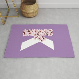 Colorful capital letter K patterned with sakura twig Rug
