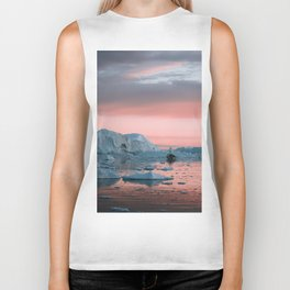 Boat in front of arctic icebergs during sunset Biker Tank