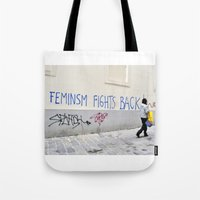 feminism Tote Bags featuring Feminism fights back by SpaceoperaImage