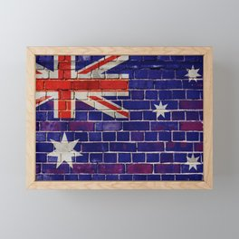 Australia flag on a brick wall Framed Mini Art Print