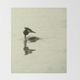 Photograph of a Grebe reflecting in the water Throw Blanket