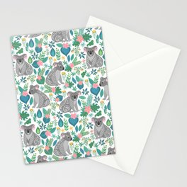 Cute gray koalas with ornaments, tropical flowers and leaves. Seamless tropical pattern. Stationery Cards