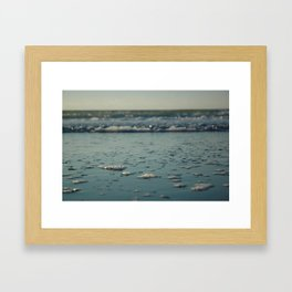 Chasing the sea foam. Framed Art Print
