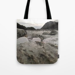 franz josef glacier in new zealand river with ice cubes rough cold Tote Bag