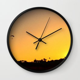 Paragliding in sunset Wall Clock