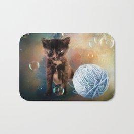 Playful cute black kitten Bath Mat
