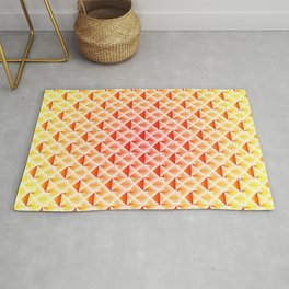 A wicker light pattern of pink squares and yellow rhombuses with diagonal volumetric triangles. Rug