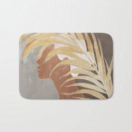 Woman with Golden Palm Leaf Bath Mat