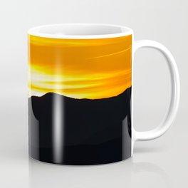 Rising sun over black mountains Coffee Mug