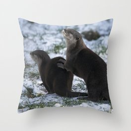 Otters In The Snow Throw Pillow