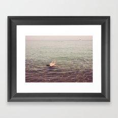 swimming in the sea Framed Art Print