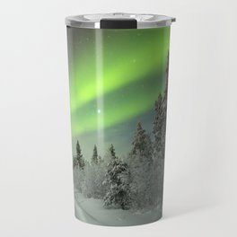 Aurora borealis over a track through winter landscape, Finnish Lapland Travel Mug