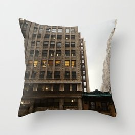 Dark Skies and New York City Buildings in Midtown Throw Pillow