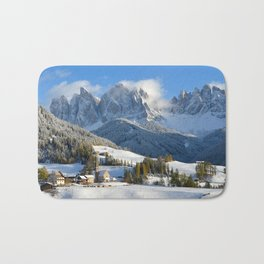 Dolomites village in the snow in winter Bath Mat