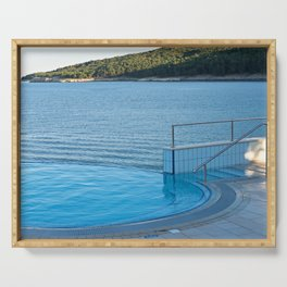 Empty infinity pool and quiet bue sea Serving Tray