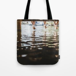 Friends relaxing on the pier Tote Bag