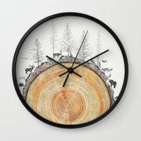 tree rings Wall Clocks featuring Tree Rings by dreamshade
