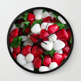 Flowers with sugared almonds as petals. Wall Clock