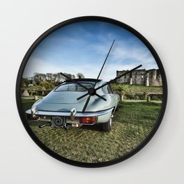 Classic car with a view Wall Clock