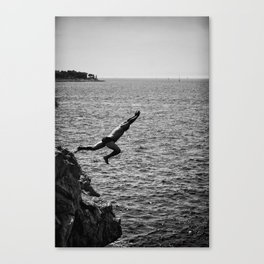 Man Jumping Off The Clif Canvas Print