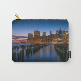 Sea side New York city in the evening with enlighten tall buildings, calm water and blue sky Carry-All Pouch
