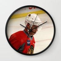 blackhawks Wall Clocks featuring jonathan toews // chicago blackhawks by Hattie Trott