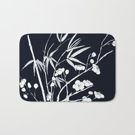 bamboo and plum flower white on black Bath Mat