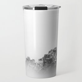 Isolated rock in a mist of sea Travel Mug
