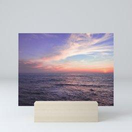 Sunset over the ocean Mini Art Print