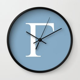 Greek letter Gamma sign on placid blue background Wall Clock