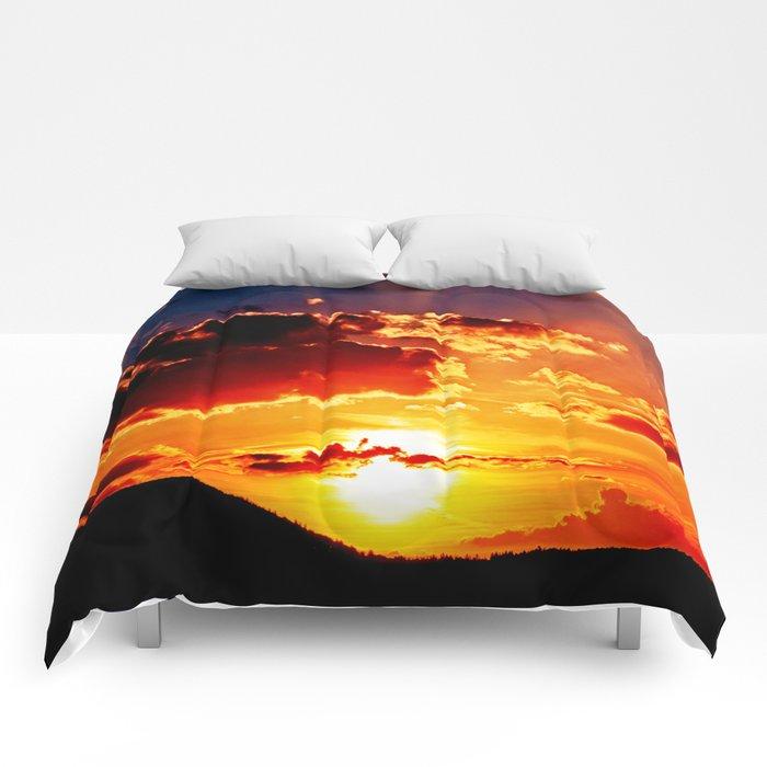 Cloudy sundown Comforters