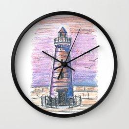 Lighthouse at sunset Wall Clock