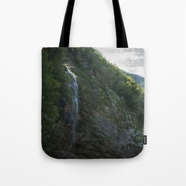 A small waterfall in the mountains Tote Bag
