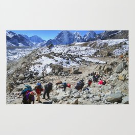 Trekking in Himalaya. Group of hikers  with backpacks   on the trek in Himalayas, trip  to the base  Rug