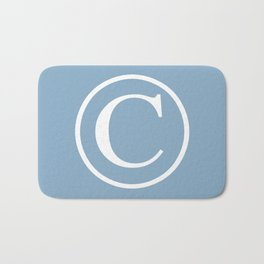 Copyright sign on placid blue background Bath Mat