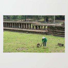 Trimming Grass With a Machete, Angkor Thom, Siem Reap, Cambodia Rug