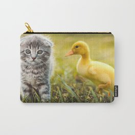 Small duckling playing with a little cat on green grass outdoors  Carry-All Pouch