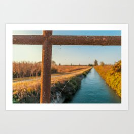 Bridge over an irrigation channel of the Lomellina at sunset Art Print