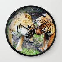 tigers Wall Clocks featuring Tigers by Irene Jaramillo