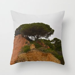 Cypress tree on red rocks Throw Pillow