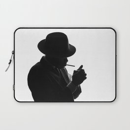 Silhouette of private detective in old fashion hat lights a cigarette Laptop Sleeve