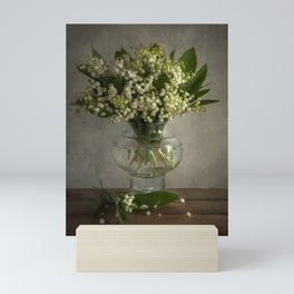 Still life with a boquet of fresh lilies of the valley Mini Art Print
