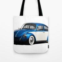 volkswagen Tote Bags featuring Volkswagen Beetle by cjsphotos