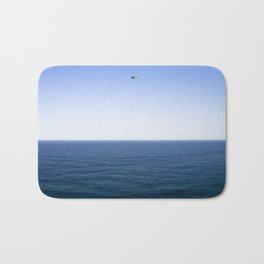 Classic plane over the ocean Bath Mat