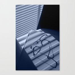 Eye glasses, book and venetian blind shadows in blue Canvas Print