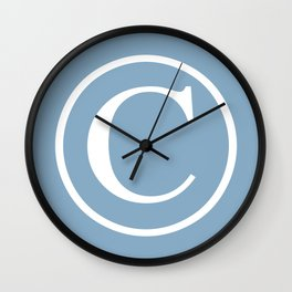 Copyright sign on placid blue background Wall Clock