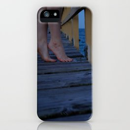 Woman standing on the edge of a pier iPhone Case