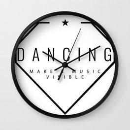 Dancing is music made visible. Wall Clock