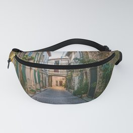 Little alley in the medieval village of Antibes in a sunny winter day Fanny Pack