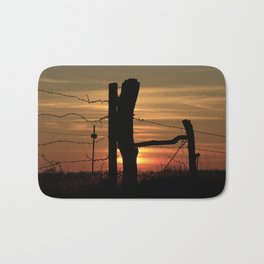 Kansas Colorful Sunset with a Barb wire Fence Silhouette. Bath Mat